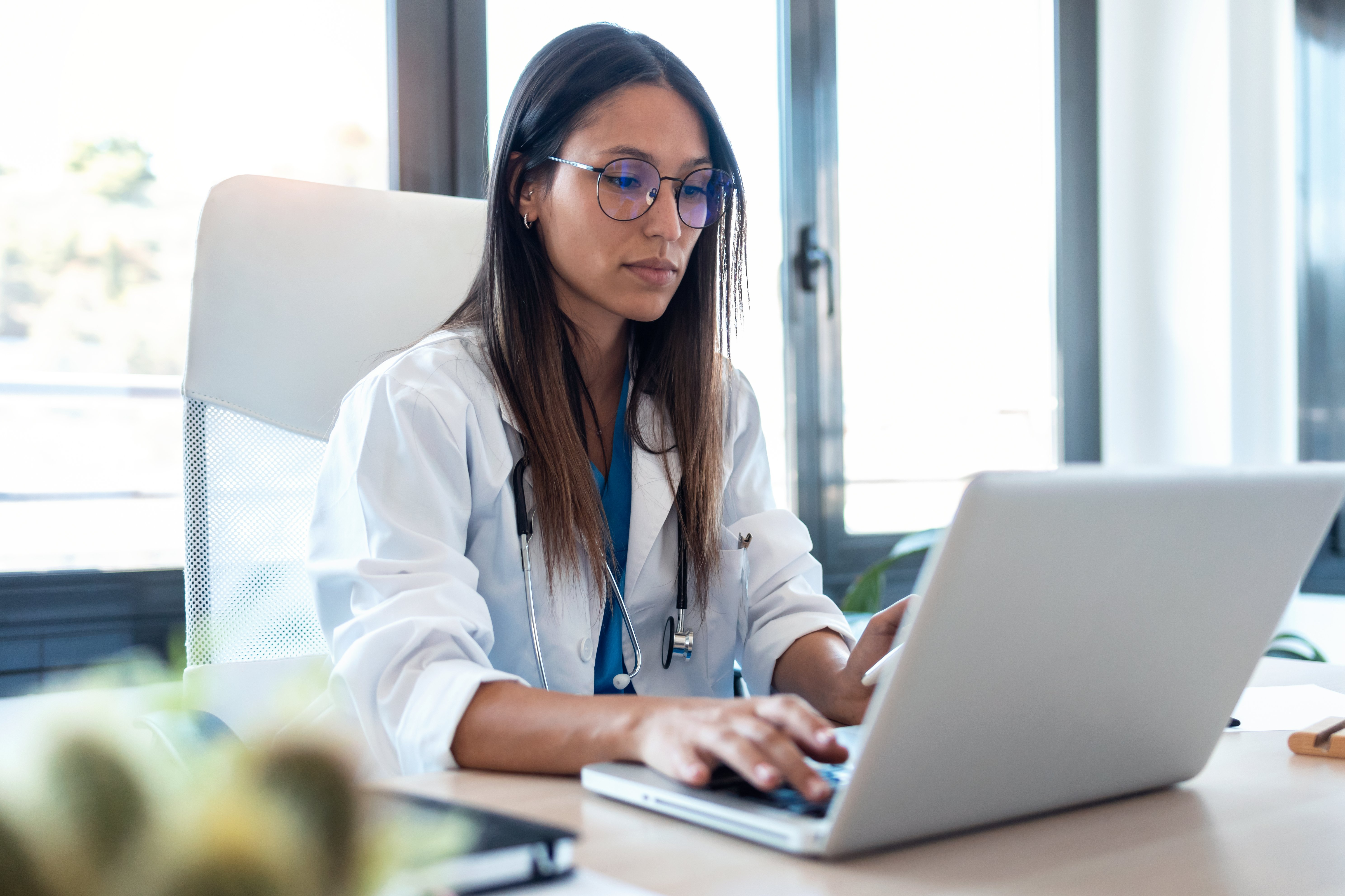 pharmacist on computer in office